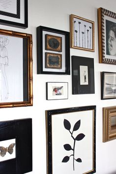Gallery Wall with black and gold frames........................................