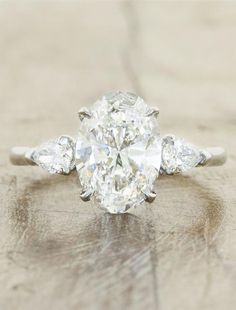 oval diamond three stone engagement ring, pear side diamonds