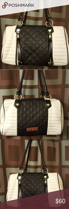 Black and white Betsey Johnson purse Black and white Betsey Johnson purse with black and white quilting in great condition has a tiny bit of fray (Shown in photo) not really noticeable other than that in excellent condition Betsey Johnson Bags