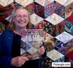 holding my book in front of quilt