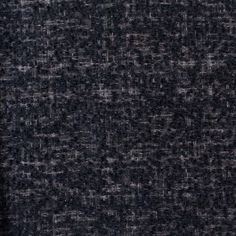 We love this wool boucle from Marc Jacobs. It's super-soft to the touch, and it has a smooth hand, almost like the yarns have been felted. Medium-weight. We'd turn this into jackets, coats and skirts that we'd wear for years. Black and gray.
