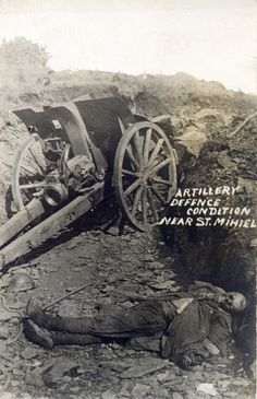 An often seen picture. A long dead (?) French artilleryman lies beside his field gun somewhere near Saint Mihiel 1918.  The Battle of Saint-Mihiel was a World War I battle fought between September 12 - 15, 1918, involving the American Expeditionary Force and 48,000 French troops under the command of U.S. General John J. Pershing.  The United States Army Air Service (which later became the United States Air Force) played a significant role in this action.