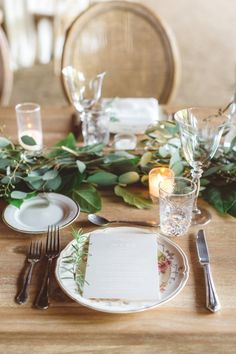 Rustic elegant wedding table covered in eucalyptus: http://www.stylemepretty.com/california-weddings/solvang/2016/09/12/rustic-chic-ranch-wedding-in-california/ Photography: Anna Delores - http://www.annadelores.com/