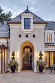 Classic French Lake House Design Exterior trim color is done to match Dover Sky Cast Stone Color Exterior stucco color is Sherwin Williams Mega Greige SW Best Exterior Paint, Exterior Paint Colors For House, Paint Colors For Home, Exterior Colors, Exterior Design, Paint Colours, Rustic Exterior, Stucco Exterior, Wall Exterior