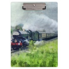 """Steam Train Clipboard featuring GWR 6000 class 'King George V' passing through Corsham station (Wiltshire) in 1983 Excellent for note-taking and organizing important papers, these  ultra-sturdy acrylic clipboards will keep you on track and in style. Dimensions:  12.5""""l x 9""""w"""
