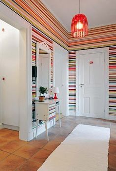 Bright horizontal striped wallpaper in the entry