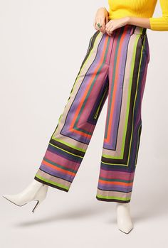 """The Aura Pant is an organic cotton high waist pant in arpeggio stripe. Features a wide cropped leg, belt loops, and side pockets. Please note: print placement may vary slightly.  - 100% Cotton - Machine wash cold, tumble dry low - Fabric is woven by artisans in India  Measurements: Waist: 25"""" Rise: 13"""" Inseam: 28"""" Leg Opening: 21"""" Measurements from size 0  Model shown wearing a size 0"""