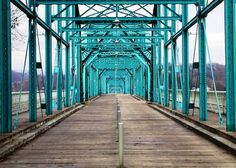 At 2,370 feet (722 meters), the Walnut Street Bridge in Chattanooga, Tennessee USA boasts to be the longest pedestrian bridge in the world. It was built in 1891 and renovated just over one hundred years later. The bridge spans over the Tennessee River from the city's downtown on one side to a park and restaurant district on the other.