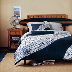 surf board headboard and I love the comforter, too!!