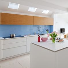 This fresh, powder-blue glass splashback by Roundhouse adds a freshness to this scheme and softens the clinical look of the modern minimalist cabinetry Kitchen Cabinetry, Kitchen Flooring, Kitchen Furniture, Kitchen Island With Sink, Kitchen Colour Schemes, Kitchen Trends, Kitchen Ideas, Family Kitchen, Kitchen Pictures