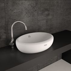 Moove washbasin 60 Oval washbasin made in ceramic. This washbasin is one of the items of Moove collection: a complete series of products for bathroom furnishing.