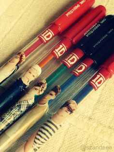 "I have these :) But when I was opening them today I noticed that Harry, Zayn, Liam and Niall's pens were black and red, but then Louis' pen, of course, was silver. I was just like ""OMG SASS MASTA!!"""