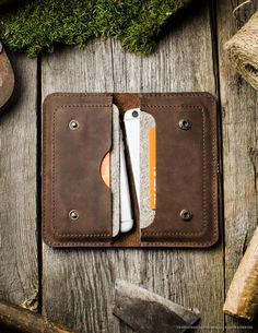 This simple wallet was designed to hold two phones, your cash or cards in one compact and safe haven. Two compartments are wool lined so phone is well protected. DESIGNED FOR: - iPhone 6 / 6s - iPhone