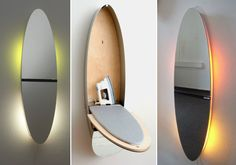 Nice modern oval wall mirror,  ironing board and storage.