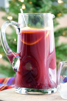 Holiday cheer starts right here with a pitcher of Pomegranate Orange Holiday Punch! COPYRIGHT © 2017 COOKING WITH CURLS
