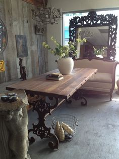 rustic table top with wrought iron base.