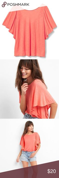 NEW GAP Short Sleeve Flutter Ruffle Top Coral XS NWT GAP Women's Flutter Ruffle Top Fresh Coral Size XS  Fit & Sizing   Straight silhouette with an easy, relaxed fit.  Hits at the hip.  Model is wearing a regular Gap size S.  product details Soft jersey knit. Flutter sleeves. Boatneck. #813572 fabric & care 100% Rayon. Machine wash. Imported. GAP Tops Tees - Short Sleeve