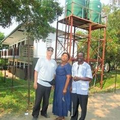 Espoir Congo director with the school directors in front of the tanks of clean water in from of the school. It has changed the lives of those in the village. Congo, Tanks, Gazebo, Action, Outdoor Structures, Cleaning, School, Water, Life