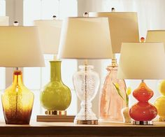 """Our """"It"""" List: Table Lamps! We're shining a light on our favorite lamps in every style. Table lamps aren't just a light source—they're statement pieces, adding an element of glitz, charm, drama, or simply carrying through your room's aesthetic. Once you've found the style that's right for you, find the right size for your space with our tips."""