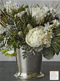 White flower arrangements are perfect for the holidays. Winter Flower Arrangements, Christmas Floral Arrangements, Winter Centerpieces, Floral Centerpieces, Centerpiece Wedding, Christmas Flowers, Winter Flowers, Winter Bouquet, Xmas Decorations