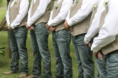 Groomsmen wore jeans, cowboy boots, vests and white dress shirts