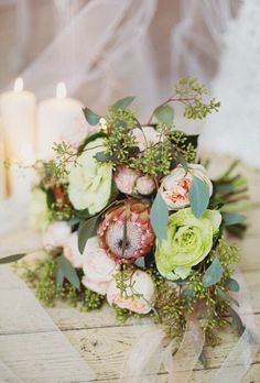 Peach bridal bouquet with protea and brassica
