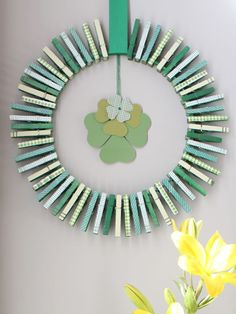 Give a pack of clothespins a quick coat of spray paint and then top them with patterned washi tape. #stpatricksday #wreaths