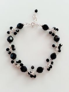 This bracelet is made with sterling silver and Swarovski crystals in black. The bracelet measures 7.5 inches (about 19cm) with a 0.5 inch extension. All wirework is done by hand. It is perfect as a br