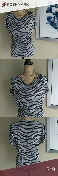 MK Animal Print Top Size XS / Sm MICHAEL Michael Kors Top. Size XSmall / Small. Cute Zebra Print Top. Great for work, church or a night out. Draped in front, with relaxed sleeves. Slightly tighter on body. Has a ton of stretch. Really figure flattering. Looks great with a pencil skirt, or black pants & tall heeled boots. In fabulous condition! Absolutely no defects of any kind. Feel free to ask any questions. MAKE ME AN OFFER! FREE GIFT with every purchase! Bundle for further discounts…