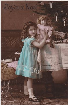 circa 1910..Beautiful Edwardian Girl in Blue Dress with Porcelain Doll