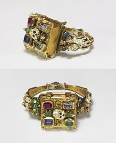 aleyma: Memento mori ring, made in Flanders, Belgium, or France, 1526-1575 (source). The book opens to reveal an inscription and a figure with a hourglass and skull. The cover has snakes and toads around the central skull, figures representing the Fall and Expulsion form the shoulders of the ring, and the back of the loop features clasped hands.