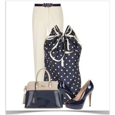 Navy and ivory polka dot top with ivory pants