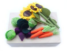 Felt Fabric Vegetable Garden Play Set Toy MiniGarden Pretend Food Veggies Set For Kids Little Gardener Vegetable Patch Little Housekeeper  The set of vegetables (5 carrots, 3 beets, 3 lettuces) and 3 sunflowers. All made of felt and textile. Together with a vegetable patch will please both girls and boys! They will drill, care of seedlings and then have a good crop and use it in the kitchen. This vegetable patch is in playwood box.  Vegetables and flowers can be planted in any row — they are…