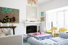 A modern yet eclectic living space with lots of bold pattern and pastel color