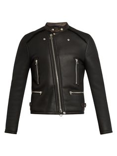 Lanvin's black heavyweight shearling jacket has the look of a classic biker style. It's designed for a slim, collarless fit, and is detailed with slick silver-tone zips and moto-style quilted elbow pads.