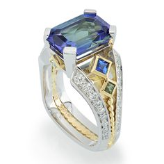 Deco Bi-Color Tanzanite Yellow Gold and Platinum Ring - Bi-Color Tanzanite set in Yellow Gold and Platinum accented with Sapphires and Diamonds. Gemstone Jewelry, Jewelry Rings, Jewelry Accessories, Fine Jewelry, Jewellery, Perfume, Rolex, Arizona, Rings N Things
