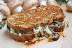 Mushroom Grilled Cheese Sandwich (aka The Mushroom Melt).  Sauteed mushrooms and onions all covered in ooey gooey melted cheese in a grilled cheese sandwich.  Buttery, toasty, and cheesy mushroom perfection!