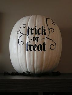 White foam pumpkin, black decal, black jewels. Great alternative to the usual orange Halloween decorations.