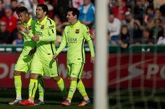 Luis Suarez (C) celebrates scoring their second goal with team mates Neymar JR. (L) and Lionel Messi (R) during the La Liga match between Granada CF and FC Barcelona at Nuevo Estadio de los Carmenes on February 28, 2015 in Granada, Spain.