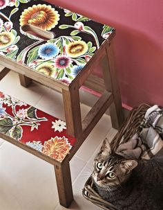 Alexandra uses colourful pieces of patterned wallpaper to customise everyday pieces of furniture, like this IKEA stool