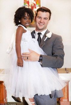 AJ & the flower girl, Starla at his wedding! Starla is a cancer survivor.