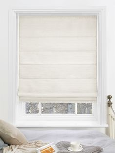 The Dupioni Faux Silk Oyster Roman Blind adds a touch of luxury to a beautiful room.
