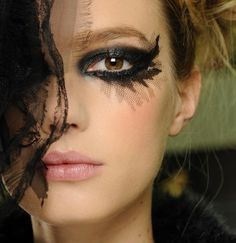 Call Me Crazy, But I Like the Exaggerated Eye at Chanel Spring 2013 Couture: Girls in the Beauty Department: glamour.com