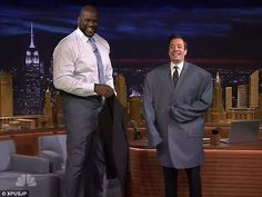 Jimmy Fallon tries on Shaquille O'Neal's jacket on The Tonight Show