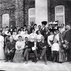 Booker T Washington poses with Teachers,  Trustees & Andrew Carnegie in front of the Carnegie Library Bldg at the Tuskegee Institute  - April 1906 from the Wilcox Photo Collection