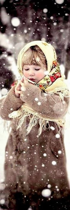 Such a sweet innocent looking little child! Her coat and the thick warm fringed babushka are something most would associate with eastern Europe. I used to wear a headscarf like that - warmer and blocked the wind better than any hat ever could!