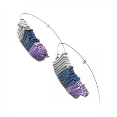 Earrings made in steel with draped leather and freshwater pearls.