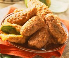 Jalapeno Poppers - Treat hot chile devotees to these deep-fried cheddar cheese-stuffed peppers.
