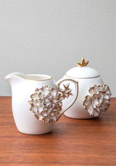 Gilded Up and Go Cream and Sugar Set. On mornings when you find yourself with more time than usual, you pair a relaxing cup of coffee with this charming cream and sugar set from One Hundred 80 Degrees. #white #wedding #modcloth