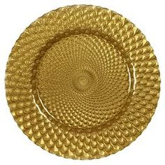 """Bring style and flair to your tabletop with this entertaining essential, perfect for decadent soirees and weeknight dinners alike.  Product: Set of 4 charger platesConstruction Material: GlassColor: GoldFeatures:  HandcraftedFits standard size dinner platesTextured underside Dimensions: 13"""" Diameter eachCleaning and Care: Dishwasher safe"""
